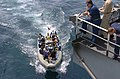 US Navy 050512-N-7833F-011 Sailors assigned to the guided missile destroyer USS Mustin (DDG 89) transport Motor Vessel Olympias crew members to the Nimitz-class aircraft carrier USS Carl Vinson (CVN 70) in a rigged hull inflat.jpg