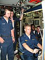 US Navy 050613-N-0000R-001 Midshipman Christopher Olen Johnson, a student at Virginia Military Institute, takes the helm of the Los Angeles-class fast attack submarine USS Toledo (SSN 769).jpg