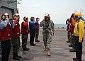 US Navy 050831-N-5561D-001 Commander, Joint Task Force Katrina, U.S. Army Lt. Gen. Russel Honore, salutes as he walks through rainbow sideboys on the flight deck aboard the amphibious assault ship USS Bataan (LHD 5).jpg