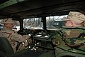 US Navy 060307-N-6764G-046 Storekeeper 2nd Class Eddie Burgos and Intelligence Specialist 2nd Class Mike Tomazin assigned to the Naval Customs Battalion Quebec, practice humvee operations.jpg