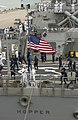 US Navy 060614-N-9851B-003 Sailors aboard Arleigh Burke-class guided missile destroyer USS Hopper (DDG 70) lower the American Flag on the ship's fantail as Hopper shifts colors for getting underway.jpg