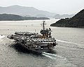 US Navy 061106-N-6106R-874 USS Kitty Hawk (CV 63) sails into the harbor of Sasebo during a scheduled port visit.jpg
