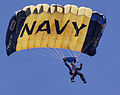 US Navy 070308-N-4163T-149 A member of the U.S. Navy Parachute Demonstration Team Leap Frogs descends into San Diego's Qualcomm Stadium as part of a training session.jpg