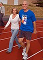US Navy 070602-N-6247M-007 Capt. Martin Clark and Dental Technician Shantel Porter walk laps around the track during the Relay for Life.jpg