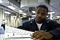 US Navy 070625-N-0913B-010 Aviation Ordnanceman 3rd Class Anthony Chatfield, temporarily assigned to laundry from weapons division, reviews the laundry log.jpg