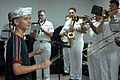 US Navy 070706-N-0194K-115 Matthew Giraldo, a music student at the Colon School for the Fine Arts, leads the Navy Show Band in a rendition of.jpg