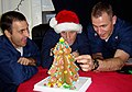 US Navy 071219-N-1786N-056 Mass Communication Specialist Seaman Mike Leporati, left, Mass Communication Specialist Seaman Jon Husman and Mass Communication Specialist 2nd Class Jason Zuidema decorate a ginger bread Christmas tr.jpg