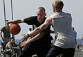 US Navy 080608-N-3316L-077 Seaman Blake Petenbrink tries to drive around a defender in a basketball game during a steel beach picnic aboard the amphibious transport dock USS Nashville (LPD 13).jpg