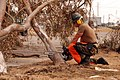 US Navy 080919-N-0193M-192 Construction Mechanic 3rd Class Timothy Long cuts down a fallen tree.jpg