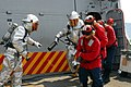 US Navy 081006-N-2013O-001 Sailors respond to a simulated fire.jpg
