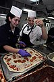 US Navy 090320-N-4995K-009 Aerographer's Mate 3rd Class Leah Katz, a member of the 3^2 Association, and Culinary Specialist Seaman Recruit Brandi Porter prepare a pizza aboard the aircraft carrier USS Ronald Reagan (CVN 76) for.jpg