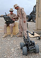 US Navy 090413-N-8547M-010 Construction Electrician 2nd Class Ryan Moberly and Utilitiesman 3rd Class Jeffrey Schuett use a MARCbot IV during a familiarization exercise.jpg