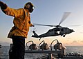 US Navy 090710-N-4236E-346 Boatswain's Mate 2nd Class Michael Trapps directs an MH-60S Sea Hawk helicopter from Helicopter Sea Combat Squadron (HSC) 22 during deck landing qualifications.jpg