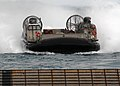 US Navy 090721-N-6692A-033 Landing Craft Air Cushion (LCAC) 8 launched from the Navy's forward-deployed amphibious assault ship USS Essex (LHD 2), prepares to enter the well deck of amphibious dock landing ship USS Tortuga (LSD.jpg