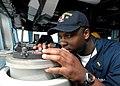 US Navy 100330-N-1559J-005 Ensign Antwan Richardson takes bearing readings on the bridge of USS Laboon (DDG 58).jpg