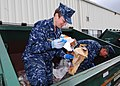 US Navy 100414-N-9520G-003 Lt. Julie Cunningham and Aviation Structural Mechanic (Equipment) Airman James Creek eparate regular trash from recyclables.jpg