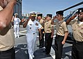 US Navy 100428-N-3265K-143 Vice Adm. Mel Williams Jr., commander of U.S. 2nd Fleet, salutes sideboys aboard the guided-missile frigate USS Halyburton (FFG 40).jpg