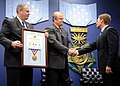 US Navy 100928-N-4790M-031 Dr. John Schupp receives the 2009 Zachary and Elizabeth Fisher Distinguished Civilian Humanitarian Award from Undersecre.jpg