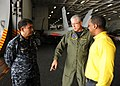 US Navy 110204-N-3374C-153 Vice Adm. Daniel P. Holloway, center, and Command Master Chief Glenn Mallo, left, talk to a Sailor from USS George H.W.jpg