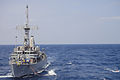 US Navy 110311-N-5185B-001 The mine countermeasures ship USS Guardian (MCM 5) conducts an underway replenishment with the Military Sealift Command.jpg