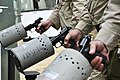 US Navy 110716-N-NX238-712 Sailors inspect their 9 mm pistol at a weapons clearing station during ULTRA 2011.jpg