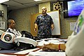 US Navy 110907-N-IZ292-043 Operations Specialist 1st Class Christian Lewis, a search and rescue planner, briefs members of the Mauritius Police For.jpg