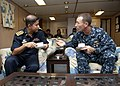 US Navy 110923-N-HA376-005 Capt. William Lovely, deputy commodore of Task Group 73.1, speaks with Capt. Shumon Mahmud Sabbir, commanding officer o.jpg