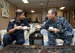 Wardroom - Image: US Navy 110923 N HA376 005 Capt. William Lovely, deputy commodore of Task Group 73.1, speaks with Capt. Shumon Mahmud Sabbir, commanding officer o