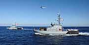 US Navy 111205-N-FV216-156 The Armed Forces of Malta counter piracy vessel protection detachment demonstrates aerial boarding procedures during Eur