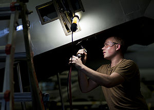 US Navy 120204-N-BT887-069 Aviation Electrician's Mate 3rd Class John Jost repairs the ramp of a C-2A Greyhound from the.jpg