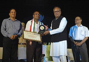 Manmohan Acharya - Acharya receives the Chinta O Chetana award for poetry