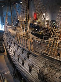 The early 17th century galleon Vasa on display at the Vasa Museum in Stockholm. Vasa, with its high stern castle and double battery decks, was a transitional design between the preferences for boarding tactics and the line of battle.