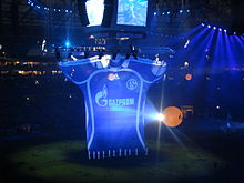 Schalke 04 royal blue trademark jersey with sponsor Gazprom elaborately showcased prior to a match with Zenit Saint Petersburg at the Veltins-Arena to celebrate Gazprom's investment of over €125 million in S04.