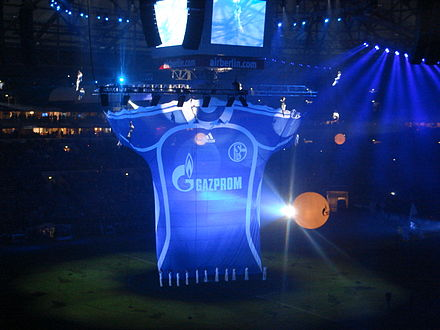 Schalke 04 royal blue trademark jersey with sponsor Gazprom elaborately showcased prior to a match with Zenit Saint Petersburg at the Veltins-Arena to celebrate Gazprom's investment of over EUR125 million in S04. VeltinsArena at friendly Schalke 04 - Zenit St. Petersburg.JPG