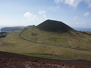 The cone of Helgafell volcano seen from the su...