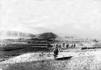 Pomona, California - View to the west-southwest down San Jose Creek from Pomona Park (now Ganesha Park) in 1904.  Elephant Hill in the center distance.