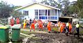 Volunteer emergency crews help to clear debris from a house in Goodna.jpg
