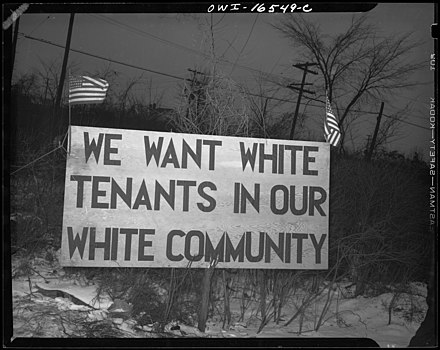 White tenants seeking to prevent blacks from moving into the housing project erected this sign, Detroit, 1942. We want white tenants.jpg