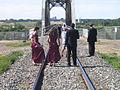 Wedding party takes photos on a Saskatchewan River railway bridge in Saskatoon -b.jpg