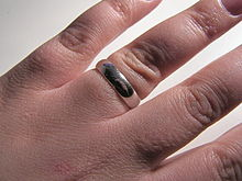 a white gold wedding ring - A Wedding Ring