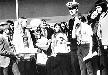 Butler greets his family in Tulsa March 1973