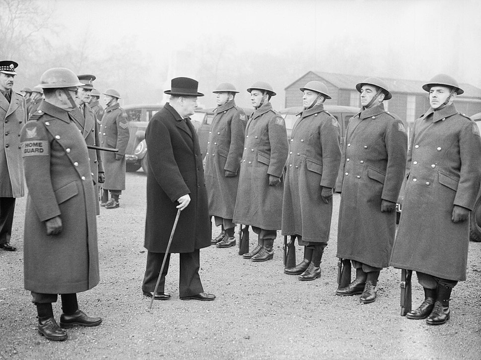 Winston Churchill inspects the 1st American Squadron of the Home Guard on Horse Guards Parade, London, 9 January 1941. H6547