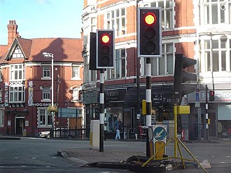 Wolverhampton - Location of the UK's first set of traffic lights at Princes Square: the poles are painted with black and white bands as they were originally.