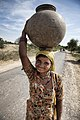 Woman with a big water pot on her head, Rajasthan (6344111524).jpg