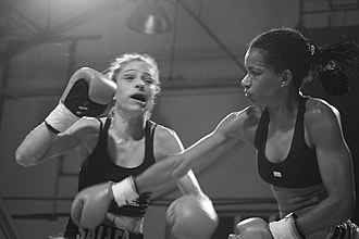 Women's boxing - Renata Cristina Dos Santos Ferreira punches Adriana Salles, São Paulo, Brazil (2006)