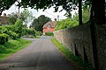 Wonky wall surrounding Kilmeston Manor - geograph.org.uk - 438408.jpg