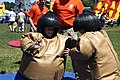 """Young Marine dependents competing in a sumo fight under 2nd Marine Logistics Group volunteers supervision at the """"Family Day"""" event on Camp Lejeune, N.C., May 11, 2012 120511-M-KS710-081.jpg"""