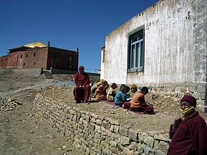 Tangyud Monastery - Young monks studying in the sun. Tangyud Gompa. 2004.