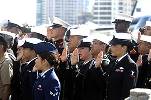 Oath of Allegiance (United States) - U.S. military personnel state the Oath of Allegiance aboard the USS Midway museum in November 2010.