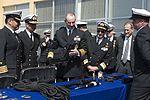 150112-N-WL435-307 Jonathan Greenert is shown some weapons of Chilean VBSS.JPG